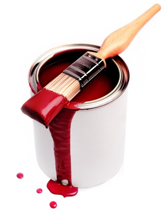 messy paint: Tin of red paint and paint brush Stock Photo