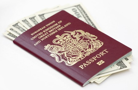 overseas visa: British (European Union) passport with US currency isolated on white