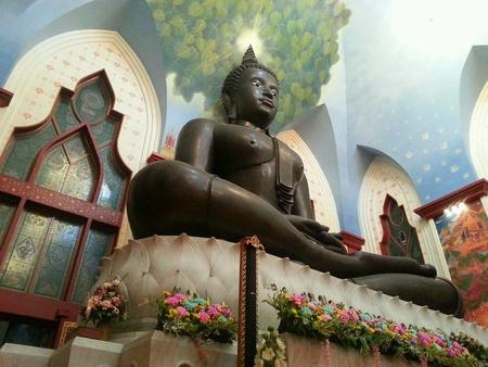 artwork: Buddha statue in the well decorated buddhist church