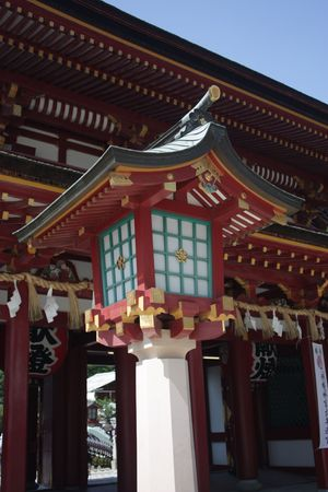 shrine: Wooden front gate lantern from Dazaifu Tenmangu shinto shrine. Fukuoka, Japan.