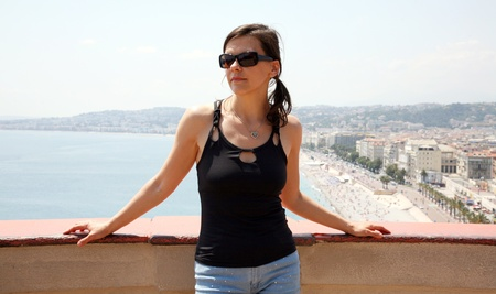 Pretty young woman and view of Nice France photo