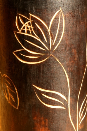 Wood teak texture with carving flower photo
