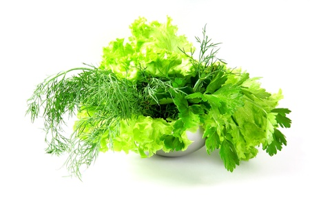 Fresh salad, parsley, dill on white background photo