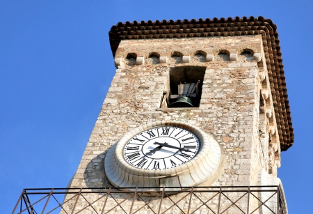 Bell tower of Church Notre Dame clock Cannes France photo
