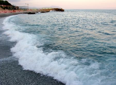 seething: Beach and sea at sunset in Genoa Italy