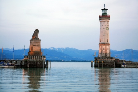 Entrance to the harbor Lindau at the Lake Constance with lighthouse and statue of bavarian lion photo
