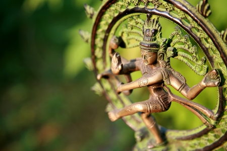 circle objects: Statue of Shiva - Lord of Dance at sunlight