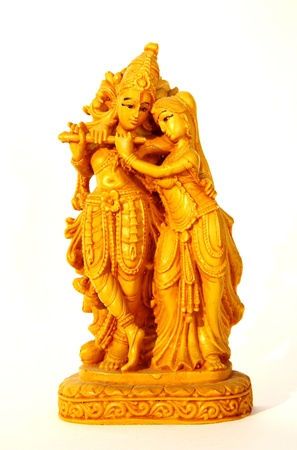 Statuette Krishna and Radha on white background photo