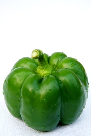 Green pepper macro on white background