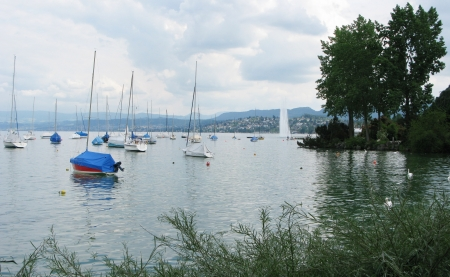 Boats and famous fountain in Lake Geneva Zurich Switzerland photo