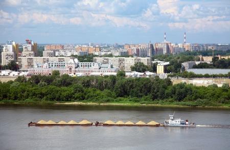 oka: Trade barge carries sand along the river Oka in Nizhny Novgorod, Russia Stock Photo