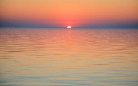 イタリアのサルデーニャ島で開いて海の日の出 写真素材