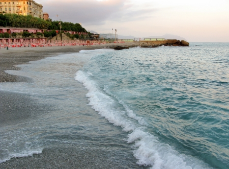 seething: Sunset on the beach in Genoa Italy Stock Photo