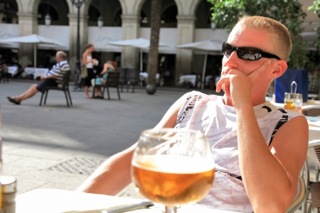 Man on vacation drinking beer photo
