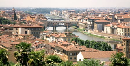 ponte vecchio: Florence with the river and ponte vecchio in warm light
