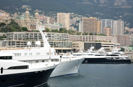 Luxurious yachts on background The Monte Carlo Casino Monaco photo