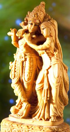 krishna: Statuette Krishna and Radha in sunlight Stock Photo