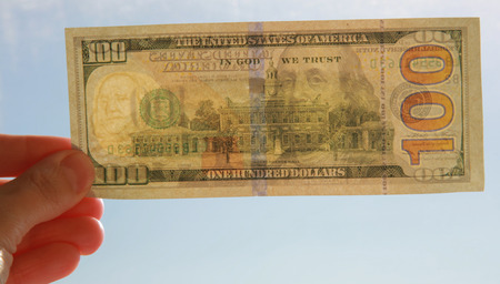 Hand with one hundred dollar banknote Stock Photo