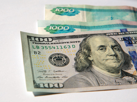 One Hundred Dollar Bills and Russian Rubles Stock Photo