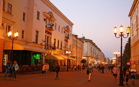 NIZHNY NOVGOROD, RUSSIA - SEPTEMBER 08, 2014: Evening autumn view of Bolshaya Pokrovskaya street. This is the most central and beautiful street,  open air museum. Very romantic in the evening at the night lights.