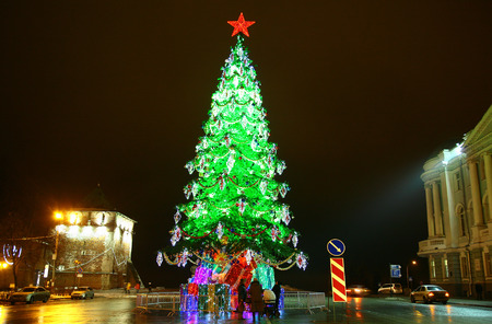 minin: Nizhny Novgorod, Russia - December 16, 2014:  Сentral Minin square decorated light Christmas trees before the New Year and Merry Christmas. Many people like to walk here.