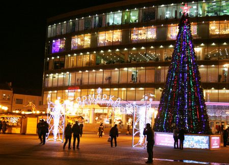 gorki: Nizhny Novgorod, Russia - December 18, 2014: Christmas Fair in front of the shopping center Republic on the Revolution square. This is a very popular place for shopping, rest and meeting with friends.