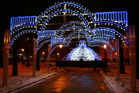 minin: Nizhny Novgorod, Russia - December 16, 2014: Christmas decorated fountain at the Minin square in the evening. Here you can meet with friends and walking with family.