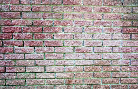 Texture of the faded old brick wall Archivio Fotografico