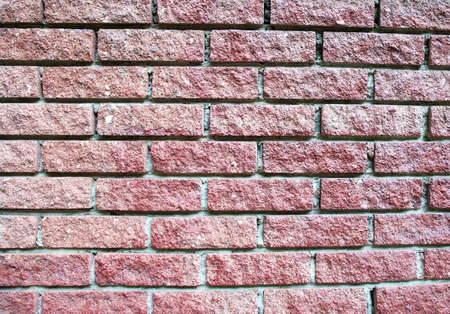 Texture of dark pink brick wall texture with light