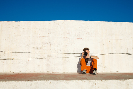 aciculum: Young man getting rest and relax on the sidewalks over the sea, blue sky and palms