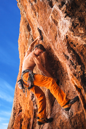 rebellious: Rebellious rock climber on the wall - bold choice of real men. Turkey, Geyikbayiri - Stock Image Stock Photo