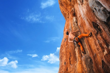 Rebellious rock climber on the wall - bold choice of real men. Turkey, Geyikbayiri - Stock Image Stock Photo