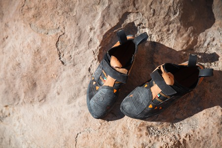 man climbing: Rock climbing equipment - shoes on the stone closeup. Top view - Stock image. Stock Photo