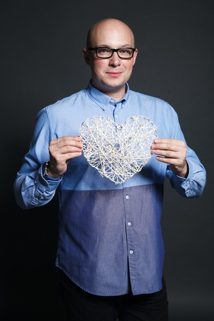 rimmed: Studio portrait with heart shape - valentines day greetings, fun, love, dating. Stock image.