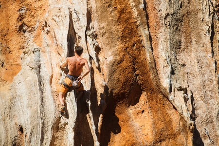 adrenaline rush: Rebelious rock climber on the wall - bold choice of real men. Dangerous adventure. Turkey, Geyikbayiri - Stock Image.
