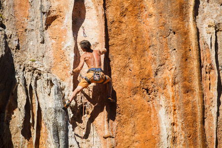 adrenaline rush: Rebelious rock climber on the wall - bold choice of real men. Dangerous adventure. Turkey, Geyikbayiri - Stock Image.