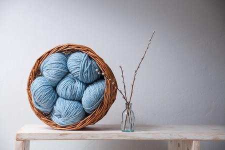 purl: Closeup of basket with colorful yarn clews. Concept of freelance creative working and happy living