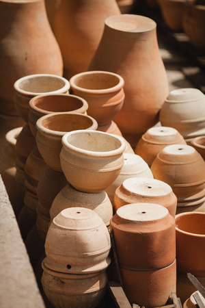 fireclay: Huge roasted ceramimc pots without glaze storage. Side view. Art and business, hobby and freelance working concept.