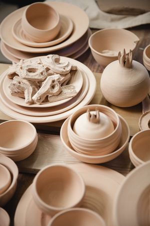 fireclay: Roasted ceramimc products without glaze. Top view, closeup. Art and business, hobby and freelance working concept.