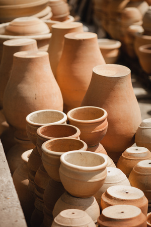 fireclay: Huge roasted ceramic pots without glaze storage. Side view. Art and business, hobby and freelance working concept. Stock Photo