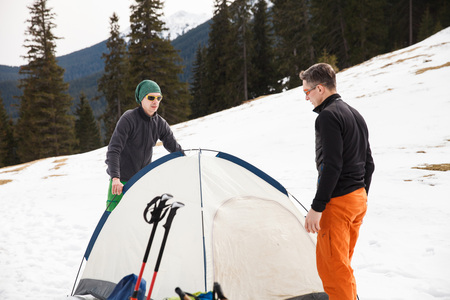 Two hikers in winter mountains installing tent. Concept of success living and free traveling  sc 1 st  123RF Stock Photos & Mountain Hiker In Advanced Base Camp With Tent On Mountainside ...