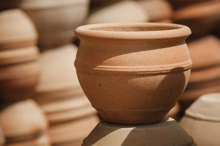 Huge roasted ceramic pots without glaze storage. Side view. Art and business, hobby and freelance working concept. Stock Photo