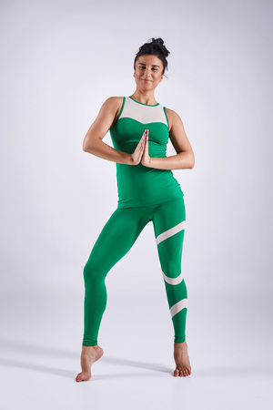cognicion: Sporty young woman doing yoga practice isolated on white background - concept of healthy life and natural balance between body and mental development Foto de archivo