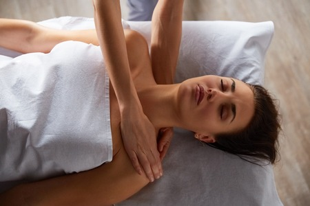 Close-up of female enjoying relaxing body massage made by masseuse with forearms and cubits in cosmetology spa centre. Body care, skin care, wellness, wellbeing, beauty treatment concept. Stock Photo