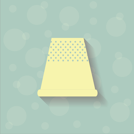 thimble: Yellow thimble on the blue background with circles