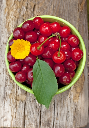 Cherry on the old wooden background Stock Photo