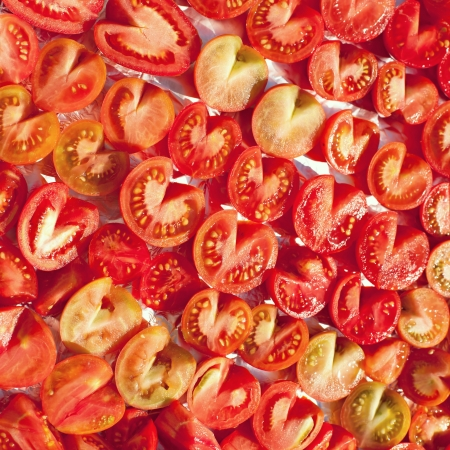 chopped tomatoes ready for drying, abstract background