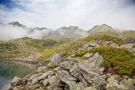 Alpine lake in the fog  Karachay–Cherkessia, Greater Caucasus, Russia