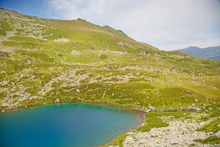 Alpine lake  Karachay–Cherkessia, Greater Caucasus, Russia Stock Photo - 17736438