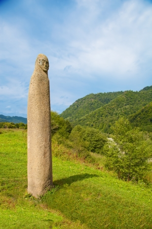 The ancient pagan fertility symbol on the background of the Caucasus Mountains  Arkhyz, Karachay-Cherkessia